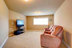 Home theatre interior. Home theatre room with comfortable armchairs and TV Royalty Free Stock Photo