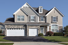 Home with three car stone garage Stock Images