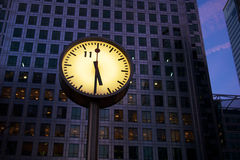 Home time. Half past five on the clock on Canada Square in Canary Wharf, London Stock Images