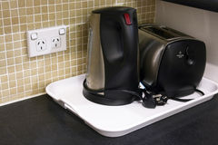Home toaster and jug on tray royalty free stock photos