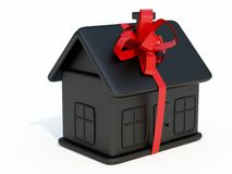 Home toy. Black home toy with ribbon isolated on white Stock Photography