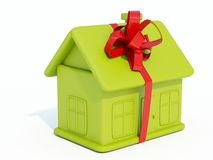 Home toy. Green home toy with ribbon isolated on white Stock Photos