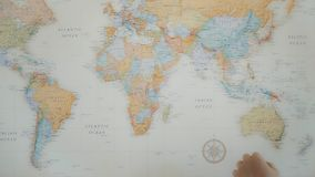 Home travel planning on world map stock video