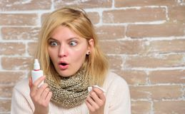 Home treatment. Effective nasal spray. Runny nose and other symptoms of cold. Nasal drops plastic bottle. Nasal spray. Runny nose remedy. Girl sick person hold stock photography