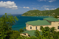 Home on tropical bay. A view overlooking a beautiful, blue, tropical bay on the island of Tortola in the British Virgin Islands with a custom built, luxury home royalty free stock photos