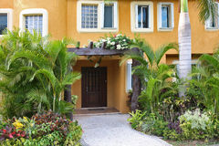 Home with tropical garden. Stock Image