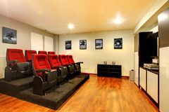 Home TV movie theater entertainment room interior. Home TV movie theater entertainment room interior with real cinema chairs royalty free stock image