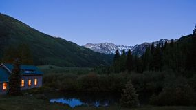 Home at Twilight in the Valley. Nightfall comes to the end of Ashcroft Valley, Colorado Stock Photos