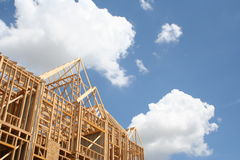 Home under construction. A view looking upwards at the side of a new, partially built wood framed house under construction Royalty Free Stock Photo