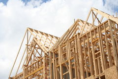Home Under Construction. An angled viewpoint of completed framework, allowing construction for a new home Royalty Free Stock Images