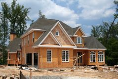 Home under construction. A brand new home still under construction royalty free stock image
