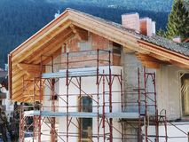 Home under construction mountain village Stock Image
