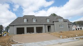 Home Under Construction in Suburbia. A home under construction in an affluent area of Tennessee Stock Photos