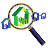 Home under magnifier glass Stock Images