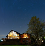 Home under night sky Royalty Free Stock Image