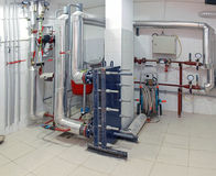 Home utility room. Utility room in house basement with boilers and pipes royalty free stock images