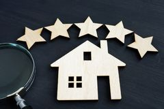 Home value concept. Five star and house model stock photography