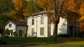 Home. Victorian Italianate during fall colors Stock Image