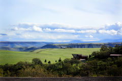 Home with a view. Territorial country side showing a home with a huge view Stock Photography