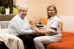 Home visit doctor with senior Stock Images