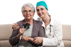 Home visit nurse and old woman portrait Stock Photo