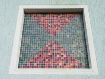 Home window with colorful mosaic, Lithuania stock photos