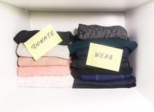 Home wardrobe with different items of clothing. Seasonal clothes sorting. Small space organization. Home wardrobe with different items of clothing. Seasonal stock photography