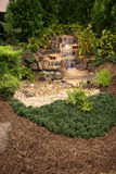 Home Water Feature. Water Feature in a backyard of a luxury home royalty free stock image