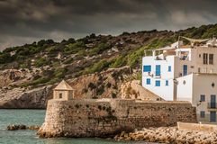 Home on waters edge in Ibiza Royalty Free Stock Image