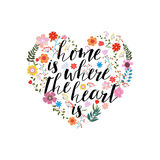 Home is the where heart  - hand drawn vector text on floral ba Royalty Free Stock Image