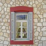 Home window, Kalavryta Greece. Vintage home window, Kalavryta Greece royalty free stock photography