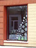 Home window with paper snowflakes, Lithuania. Home window decorated with paper snowflakes and fir trees before christmas and New Year royalty free stock images