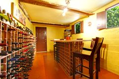 Home wine room interior with orange walls and wine. Royalty Free Stock Photography