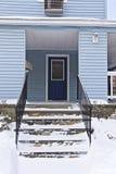 Home, Winter. Blue weatherboard home, Winter season stock photo
