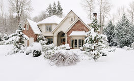 Home in winter snow. Suburban house in the snow stock image