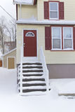 Home, Winter. Yellow and red weatherboard home, Winter season royalty free stock photos
