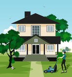 Home. Woman working at home with lawn mowers Royalty Free Stock Photography