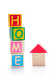 Home. Wood block home with letters on white background Stock Photography
