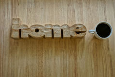 Home. (Woodcut word home) Home wood on a wooden table in the room Stock Photography