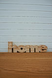 Home. (Woodcut word home) Home wood on a wooden table in the room Stock Photo