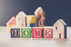 Home wooden toy model, Miniature houses for loan purchase concept building blocks arranged in row background.  royalty free stock photos
