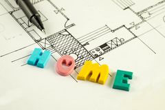 Home word and pen on blueprints and floor plan, architecture Stock Photos