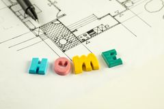 Home word and pen on blueprints and floor plan, architecture Royalty Free Stock Photos