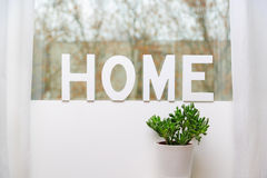 Home. The word home written in wooden letters in house on the window seal Royalty Free Stock Photography