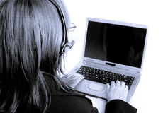 Home Work. Monochromatic image of Older senior woman's arthritic hands working on laptop Royalty Free Stock Photos