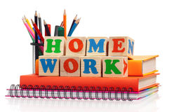 Home work. Toy letters that spell homework and books over white background Stock Image