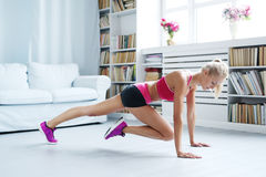 Home workout. Workout. Woman exercise at home Stock Images