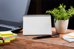 Home workplace with computer, blank notepad, copy space close up Royalty Free Stock Photo