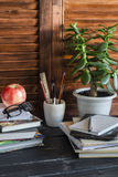 Home workspace  and accessories for work, training and education - books, magazines, notebooks, notepads, pens, pencils, tablet, g Royalty Free Stock Photography
