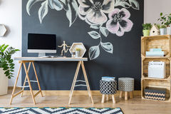 Home workspace with diy regale. And upholstered pouf Royalty Free Stock Image